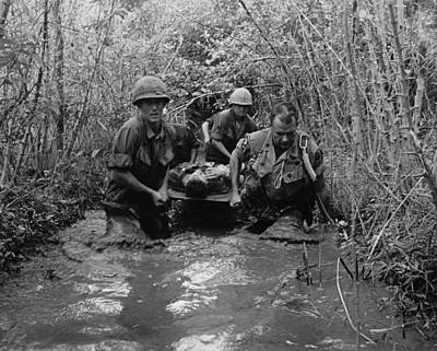 Vietnam War. Us Soldiers Carry Poster by Everett