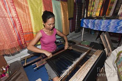 Weaving On A Loom Poster by Reinhard Dirscherl