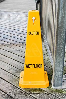 Wet Floor Warning Poster by Tom Gowanlock