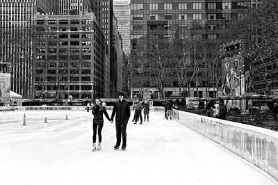 Winter Skating At Bryant Park Poster by John Rizzuto