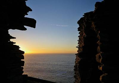 Winter Sunset At Tintagel Castle Cornwall Poster by Richard Brookes
