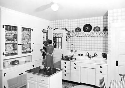 Woman Cooking In Her Kitchen Poster by Underwood Archives