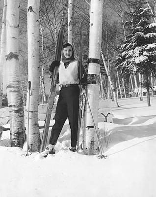 Woman With Cross Country Skis Poster by Underwood Archives