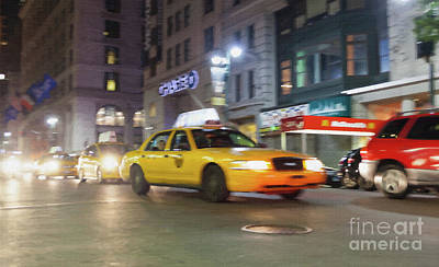 Yellow Cab At Night In New York City In Motion Blu. Poster by Antonio Gravante