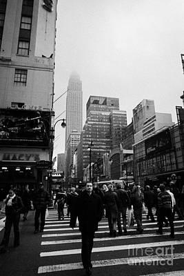 Pedestrians Crossing Crosswalk Outside Macys 7th Avenue And 34th Street Entrance New York Winter Print by Joe Fox