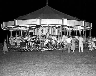 A Carousel At A Carnival Print by Underwood Archives