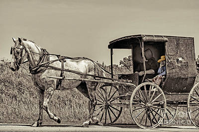 Amish Community Photograph - Amish Boy Tips Hat by Robert Frederick