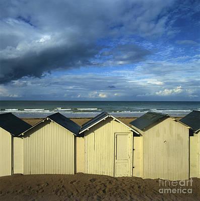 Beach Photograph - Beach Huts Under A Stormy Sky In Normandy. France. Europe by Bernard Jaubert