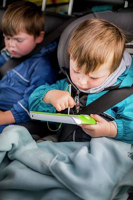 Candid Photograph - Boy In Car With A Digital Device by Samuel Ashfield