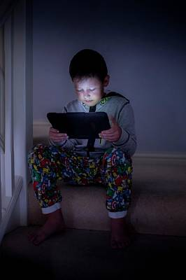 People Watching Photograph - Boy Using A Digital Tablet In The Dark by Samuel Ashfield