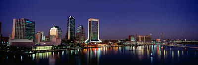 Buildings Lit Up At Night Print by Panoramic Images