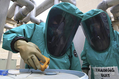 -wars And Warfare- Photograph - Cbrn Defense Specialists Check A Barrel by Stocktrek Images