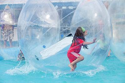 Floating Girl Photograph - Children Playing In Water Walkers by Ashley Cooper