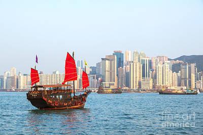 Hong Kong Photograph - Chinese Junk Boat Sailing In Hong Kong Harbor by Matteo Colombo