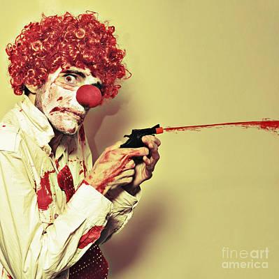 Creepy Manic Clown Shooting Blood From Cap Gun Print by Jorgo Photography - Wall Art Gallery