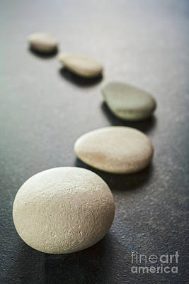 Curving Line Of Grey Pebbles On Dark Background Print by Colin and Linda McKie