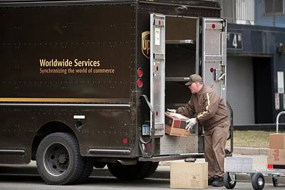 Us Postal Service Photograph - Deliver Driver Loading His Van by Jim West