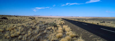 Asphalt Photograph - Desert Road Passing by Panoramic Images