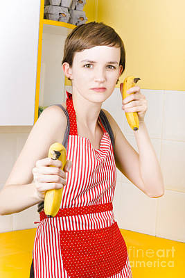Dietician Shooting Banana Guns In Kitchen Print by Jorgo Photography - Wall Art Gallery