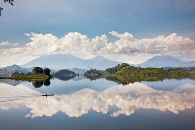 Dugout Photograph - Dugout Canoe Floating On Lake Mutanda by Martin Zwick