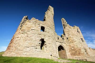 Dunstanburgh Photograph - Dunstanburgh Castle by Ashley Cooper