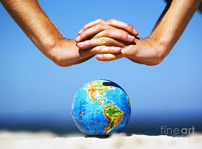 Usa Photograph - Earth Globe With Hands Over It. Conceptual Image by Michal Bednarek