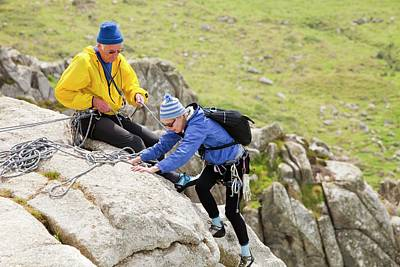Pensioner Photograph - Elderly Rock Climbers by Ashley Cooper