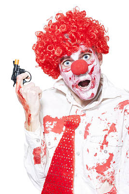 Evil Clown Holding Cap Gun On White Background Print by Jorgo Photography - Wall Art Gallery