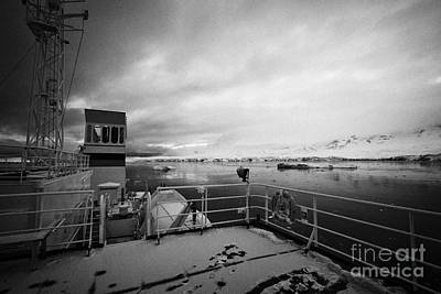 Fournier Photograph - expedition ship covered in snow moored in Fournier Bay on Anvers Island Antarctica by Joe Fox