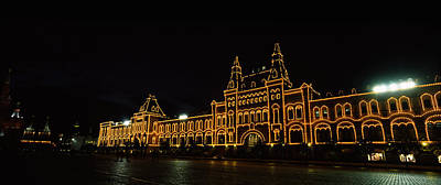 Facade Of A Building Lit Up At Night Print by Panoramic Images