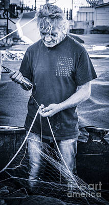 fisherman mending nets on Anzio harbour Print by Peter Noyce