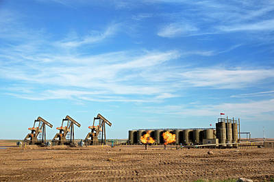Gas Flares And Pumps At An Oil Field Print by Jim West