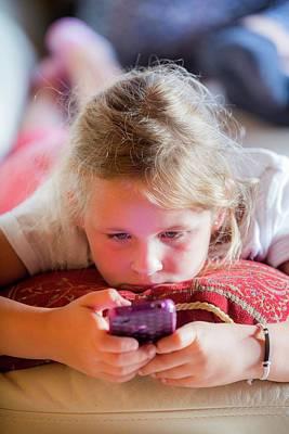 Girl Using A Smartphone Print by Samuel Ashfield