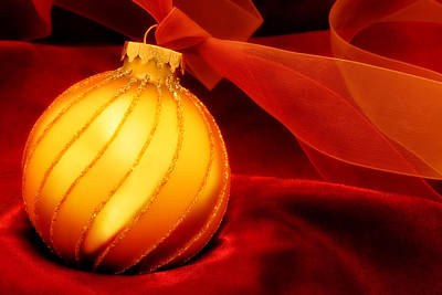 Golden Ornament With Red Ribbons Print by Carol Leigh