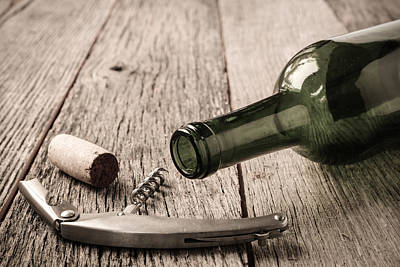 Green Wine Bottle And Cork With Red Wine And Corkscrew Print by Brandon Bourdages