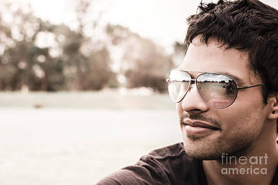 Handsome Hispanic Man Relaxing At An Outdoor Park Print by Jorgo Photography - Wall Art Gallery