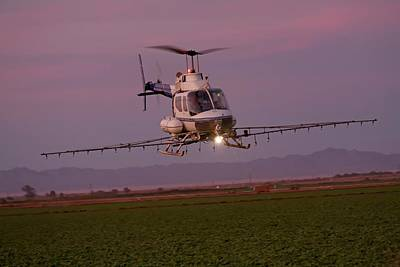 Helicopter Spraying Pesticides Print by Jim West