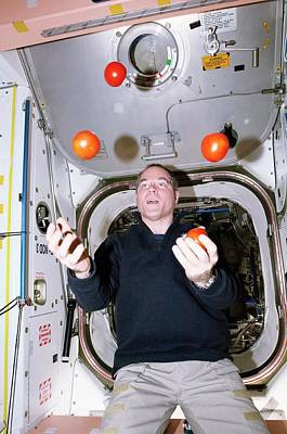 Iss Astronaut Juggling Print by Nasa