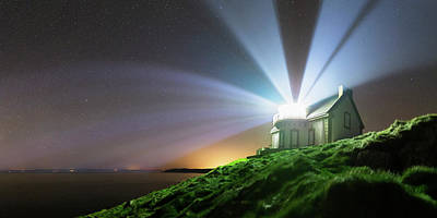 Lighthouse Beams At Night Print by Laurent Laveder
