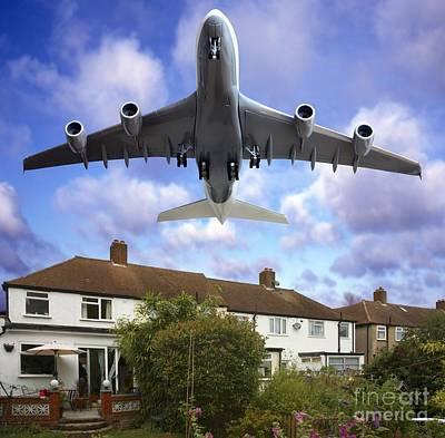 Passenger Plane Photograph - Low Flying Plane by Victor de Schwanberg