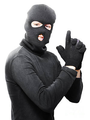 Male Criminal In Mask Making A Hand Gun Gesture Print by Jorgo Photography - Wall Art Gallery