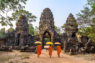 Monks With Umbrella Walking Into Angkor Wat Temple - Cambodia Print by Matteo Colombo