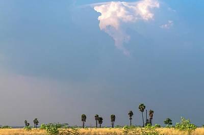 Monsoon Clouds Over Landscape Print by K Jayaram