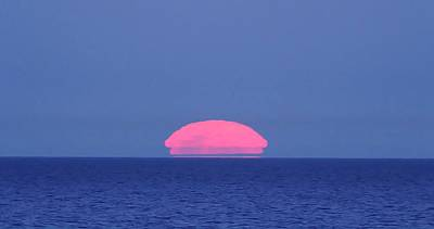 2012 Photograph - Moon Rising Over The Sea by Luis Argerich