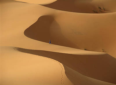 Simple Beauty In Colors Photograph - Morocco, Berber Blue Man Walking by Ian Cumming