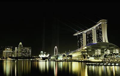 Ferris Wheel Night Photograph - Night In The City by Hardibudi