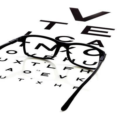Chart Photograph - Opticians Chart And A Pair Of Glasses by Science Photo Library