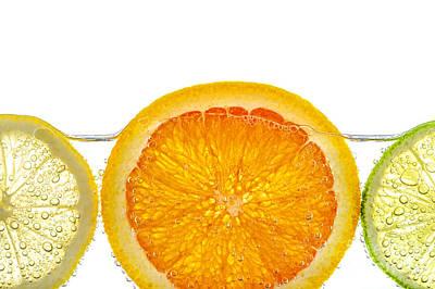 Orange Lemon And Lime Slices In Water Print by Elena Elisseeva