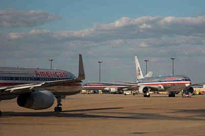 International Airport Photograph - Passenger Airliners At An Airport by Jim West