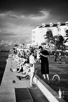 People Waiting On Waterfront For Evening Sunset Celebrations Mallory Square Key West Florida Usa Print by Joe Fox